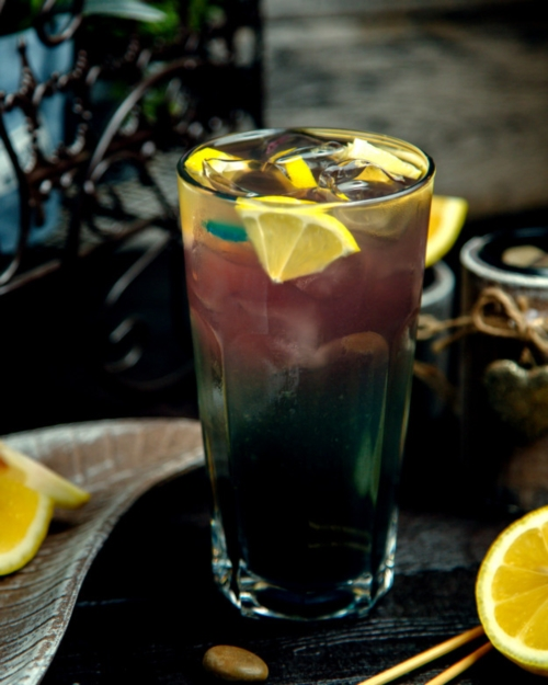 cold-drink-with-lemon-slices-with-ice-table_140725-6597.jpg